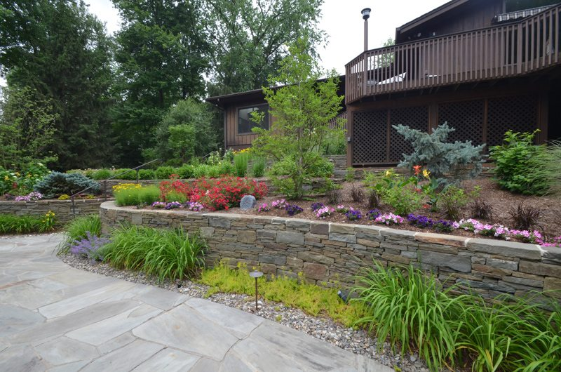 Stone Wall with Perennials and Seasonal Flowers