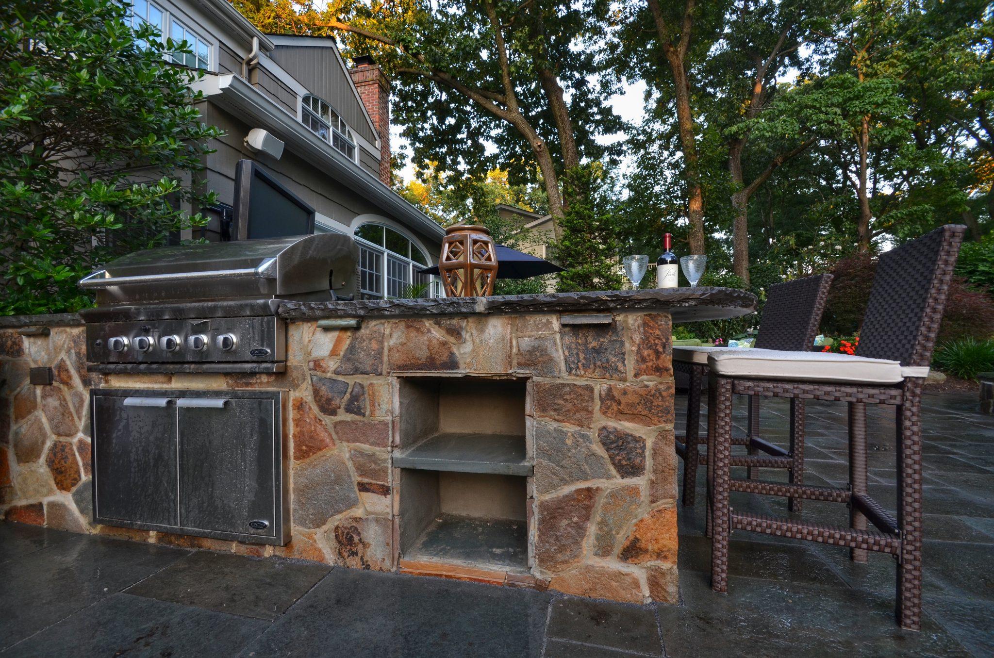 Outdoor Kitchen with Stone Veneer - Tode Landscape