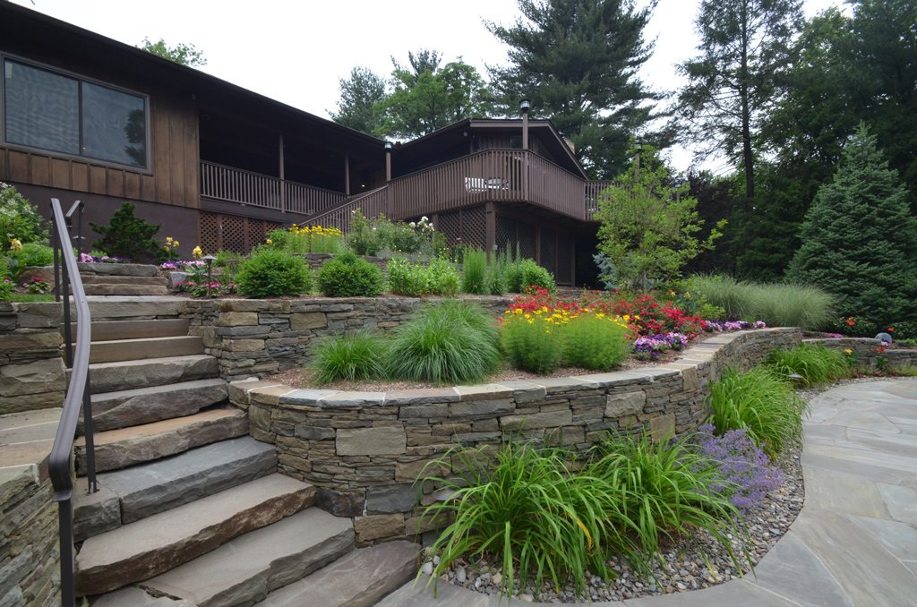 Tiered Retaining Walls And Steps With Garden On Each Level
