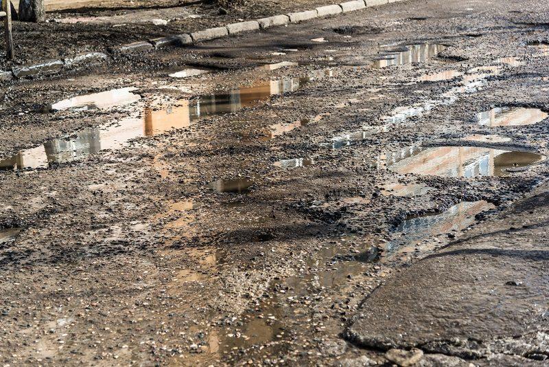 pothole puddle asphalt driveway