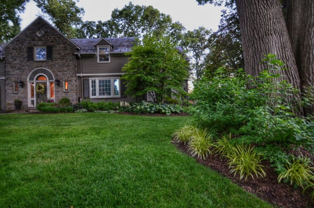 Front Yard Of Stonefront Home With Beautiful Landscaping Professional For Nice Curb