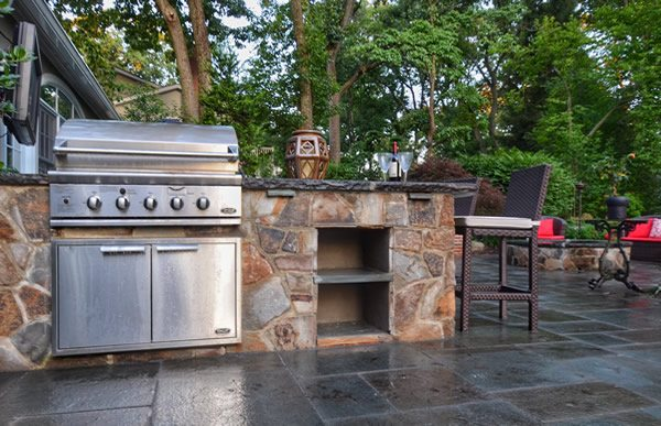 Custom Designed Outdoor Kitchen and Bar with Stone Veneer